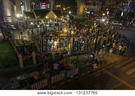 BANGKOK THAILAND - APR 17 : night scene of unidentified people worship in Erawan shrine at Ratchaprasong Junction on april 17 2016 Thailand.