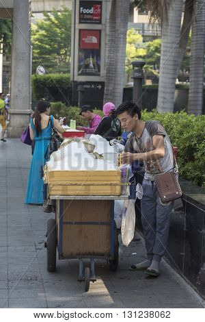 BANGKOK THAILAND - APR 24 : fresh coconut juice stall in Ratchaprasong Junction in front of CentralWorld on april 24 2016 thailand. Ratchaprasong Junction one of is famous landmark of Bangkok