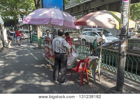 BANGKOK THAILAND - APR 24 : street food stall on street in front of Pathumwanaram temple near Siam square on april 24 2016 thailand.