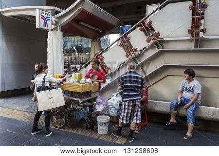 BANGKOK THAILAND - APR 24 : juice stall on street at BTS stairs in Siam square on april 24 2016 thailand.