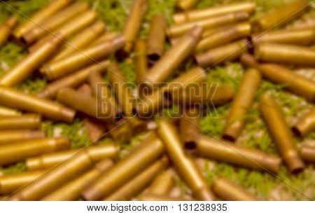 Rifle blank many bullets as abstract background
