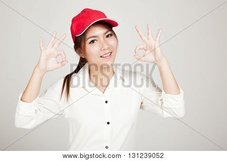 Happy Asian Girl Show Ok Sign With Red Hat