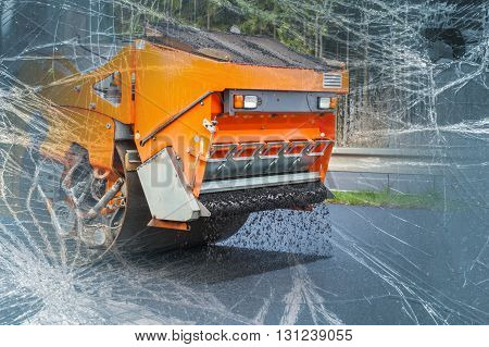 Road  orange roller flattening new asphalt, broken glass