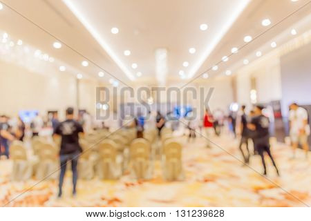 Blurred photo of people in press conference event hall business concept.