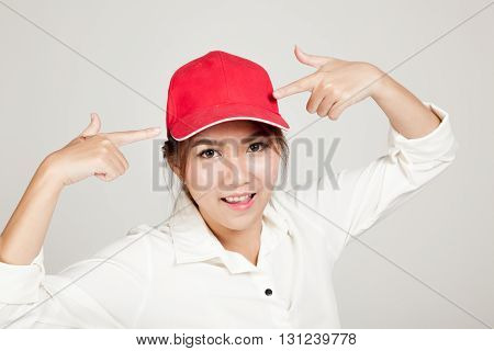 Happy Asian Girl Point To  Red Hat