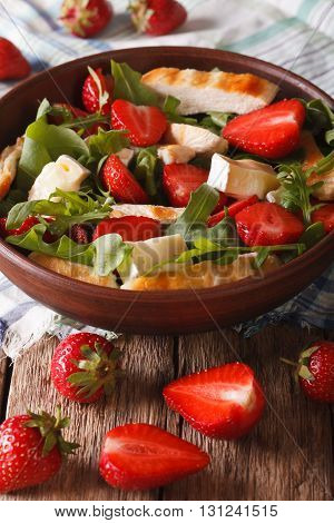 Summer Salad With Strawberries, Grilled Chicken, Brie And Arugula Close-up. Vertical