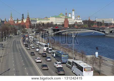 MOSCOW, RUSSIA - APRIL 12, 2016: View on Prechistenskaya waterfront Big Stone Bridge and Moscow Kremlin. Panorama of the city