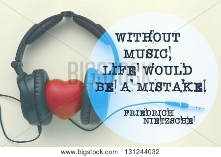 Without music life would be a mistake - ancient German philosopher Friedrich Nietzsche quote printed on image with headphones around red heart