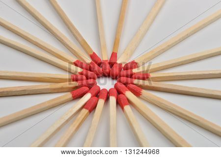 Many Red Head Matches Placed In A Circle, Head To Headon White Background
