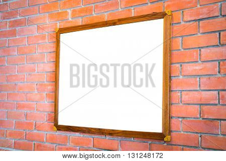 Blank wood sign on brick wall