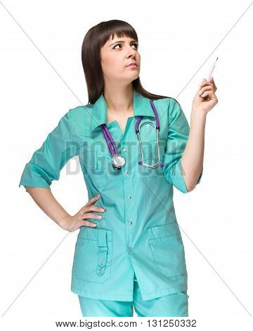 Doctor pointing. Female medical professional nurse or doctor showing copy space isolated on white background. Caucasian woman model.