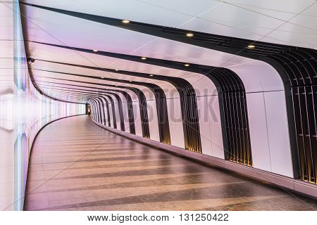 London UK - May 20 2016 - King's Cross futuristic looking tunnel the 90 meters long curved pedestrian tunnel features an LED integrated lightwall