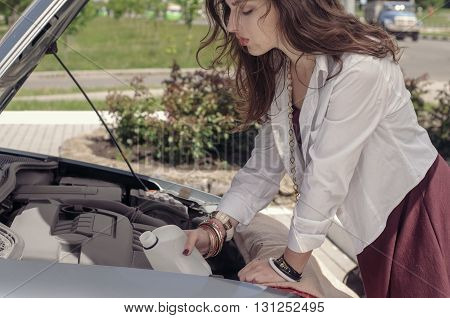 Woman Opened The Hood And She Pours Liquid