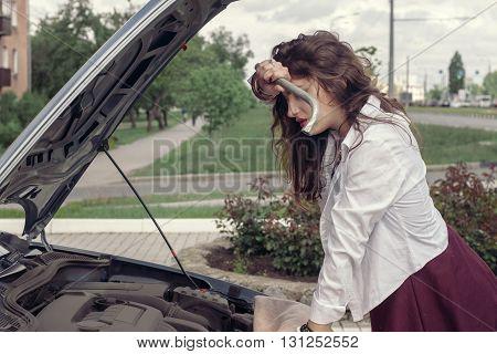 Girl Tries To Repair The Car.
