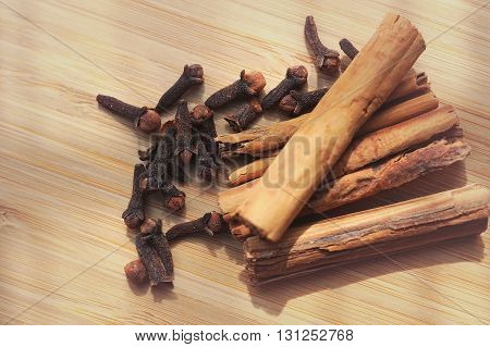 macro spice cinnamon clove on a wooden board