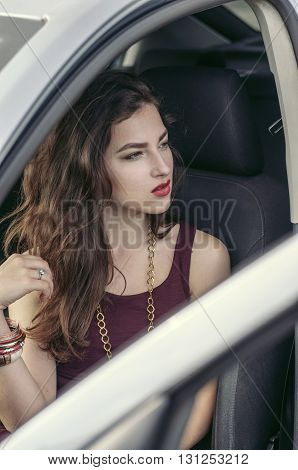 Woman Gets Out Of The Car.