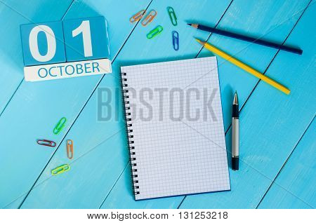 October 1st. Image of october 1 wooden color calendar on blue background. Autumn day. Empty space for text. World Vegetarian Day.