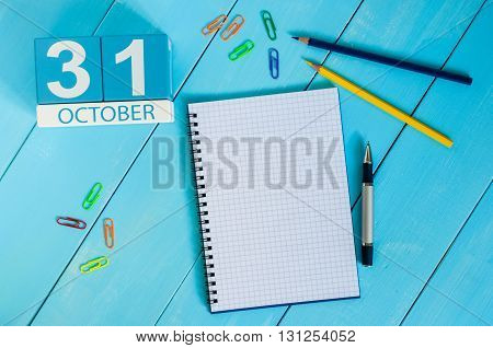 October 31st. Image of October 31 wooden color calendar on blue background. Autumn day. Empty space for text.