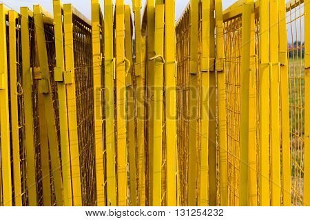 Yellow painted Iron fence texture closeup. Background