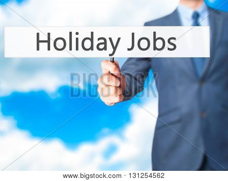 Holiday Jobs - Businessman Hand Holding Sign