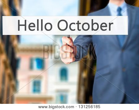 Hello October - Businessman Hand Holding Sign