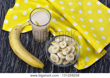 Banana juice with banana on the wooden background