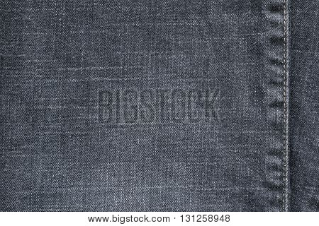 denim or rough cotton fabric or jeans material with the stitched seam for the textile textured background