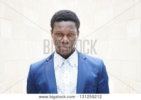 young man of african descent looking serious