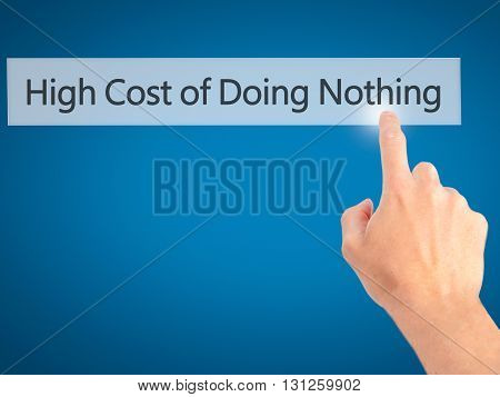High Cost Of Doing Nothing - Hand Pressing A Button On Blurred Background Concept On Visual Screen.
