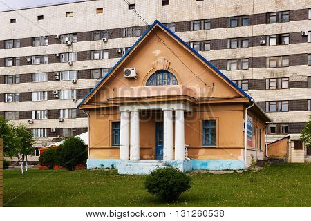 VOLGOGRAD RUSSIA - May 04 2016: Architecture not of the big Stalin house against the multi-storey vystony building. Volgograd Russia