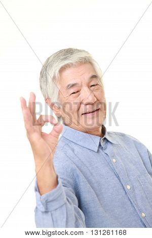 senior Japanese man showing perfect sign on white background