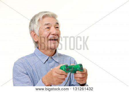 senior Japanese man enjoying a video game