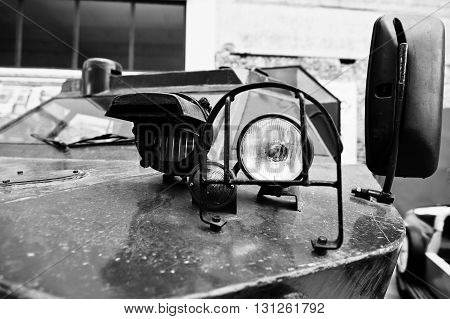 Close Up Headlight On Armored Military Car. Black And White