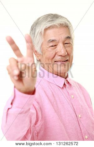 senior Japanese man showing a victory sign