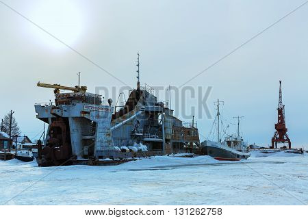 Ust-Barguzin, Russia - March 04, 2016: Pier on the shore of Lake Baikal in winter evening.
