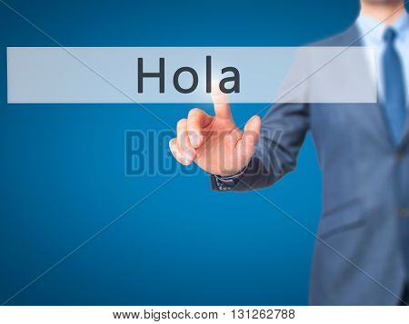 Hola - Businessman Hand Pressing Button On Touch Screen Interface.