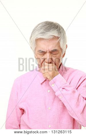 portrait of senior Japanese man coughing on white background