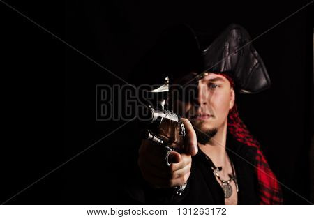 Portrait of one-eyed man-pirate, a healing in the frame of an old gun