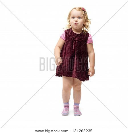 Young little girl with curly hair in purple dress standing over isolated white background