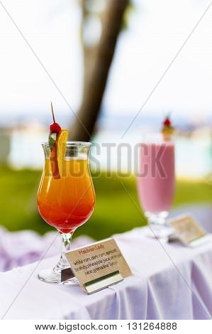 Glasses Of Cocktails On Bright Background