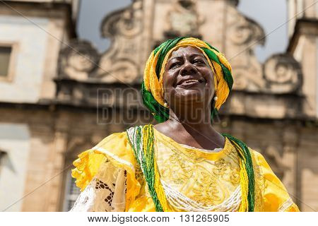 Brazilian woman of African descent wearing traditional clothes from the state of Bahia in the old colonial district of Salvador (Pelourinho)