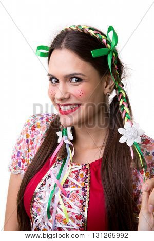 Young brunette girl wearing junina costume