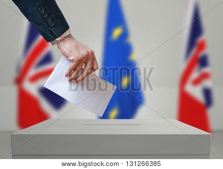 Election Or Referendum In Great Britain. Voter Holds Envelope In