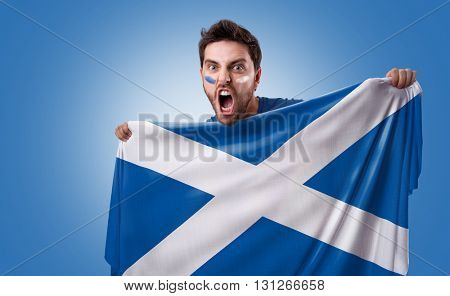 Fan holding the flag of Scotland