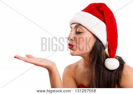 Portrait of a beautiful cheerful woman dressed as Santa