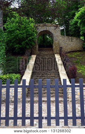 Entrance of a military cemetery to the nature with a stone staircase which rises.