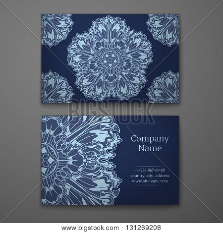 Blue business card with flower and Ornaments in Baroque Style.