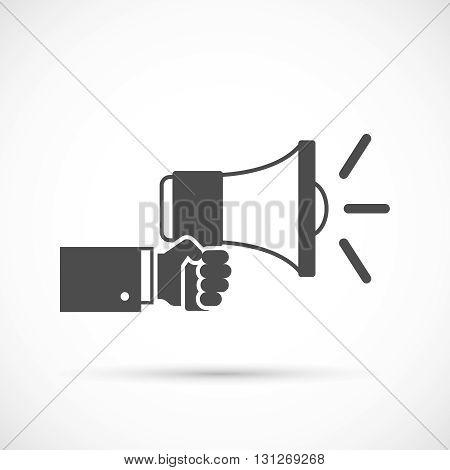 Hand holding loudspeaker. Businessman hand holding a megaphone