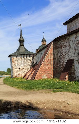 KIRILLOV, RUSSIA - JUNE 3, 2013: This tilted tower fortress Kirillo-Belozersky monastery stands on the shore of Lake Siverskoye more than 400 years.