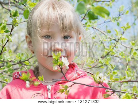 Happy Little Girl In Spring Forest